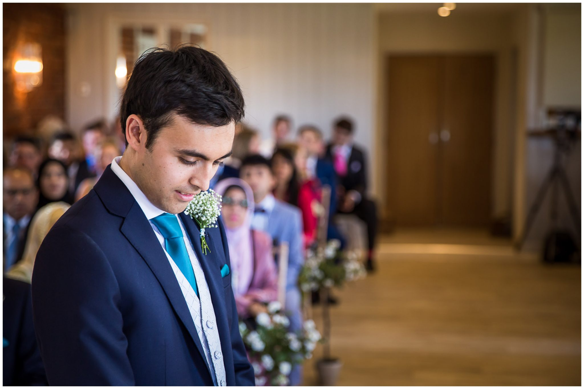 Sopley Mill Summer wedding groom waits at the end of the aisle