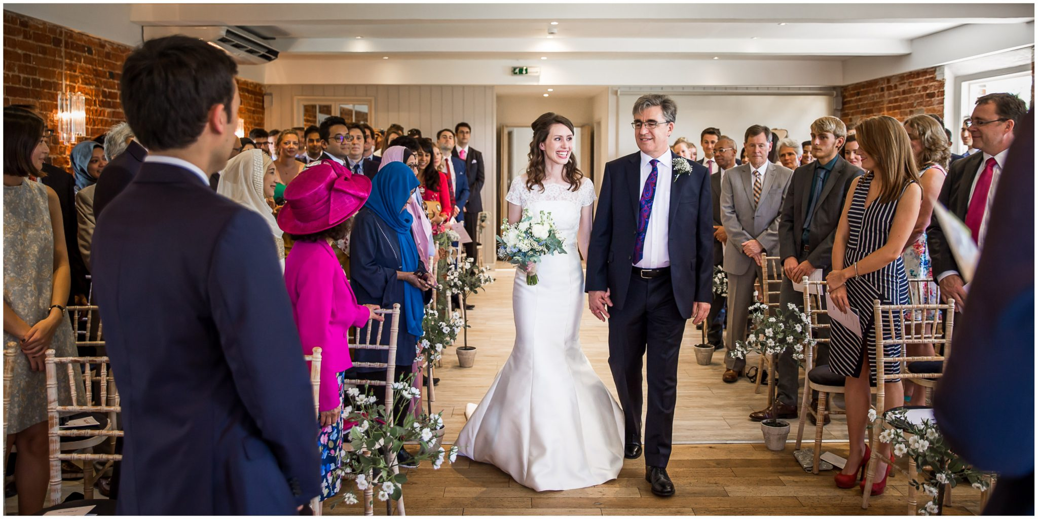 Sopley Mill Summer wedding bride walking down aisle with father