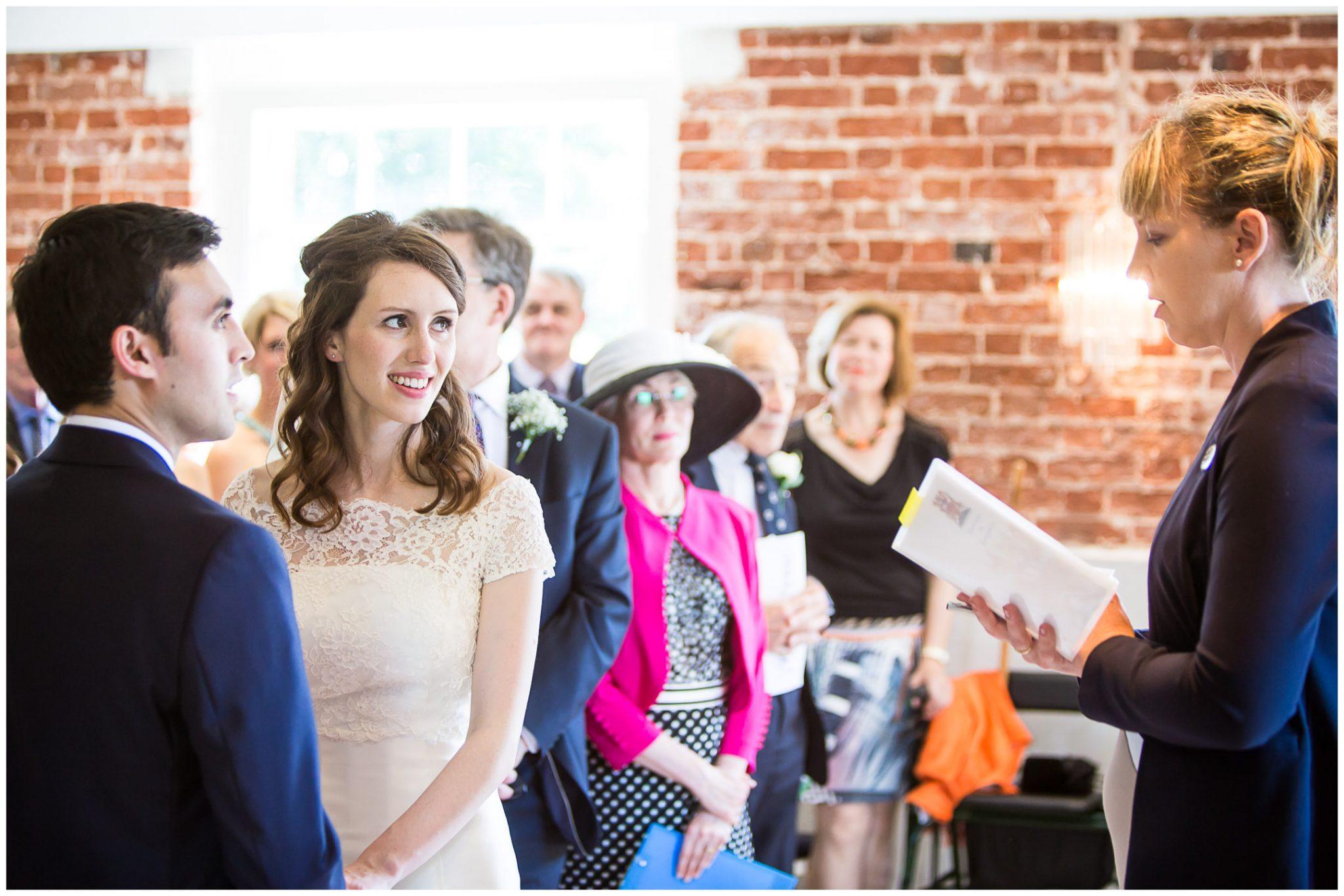 Sopley Mill Summer wedding bride, groom and registrar