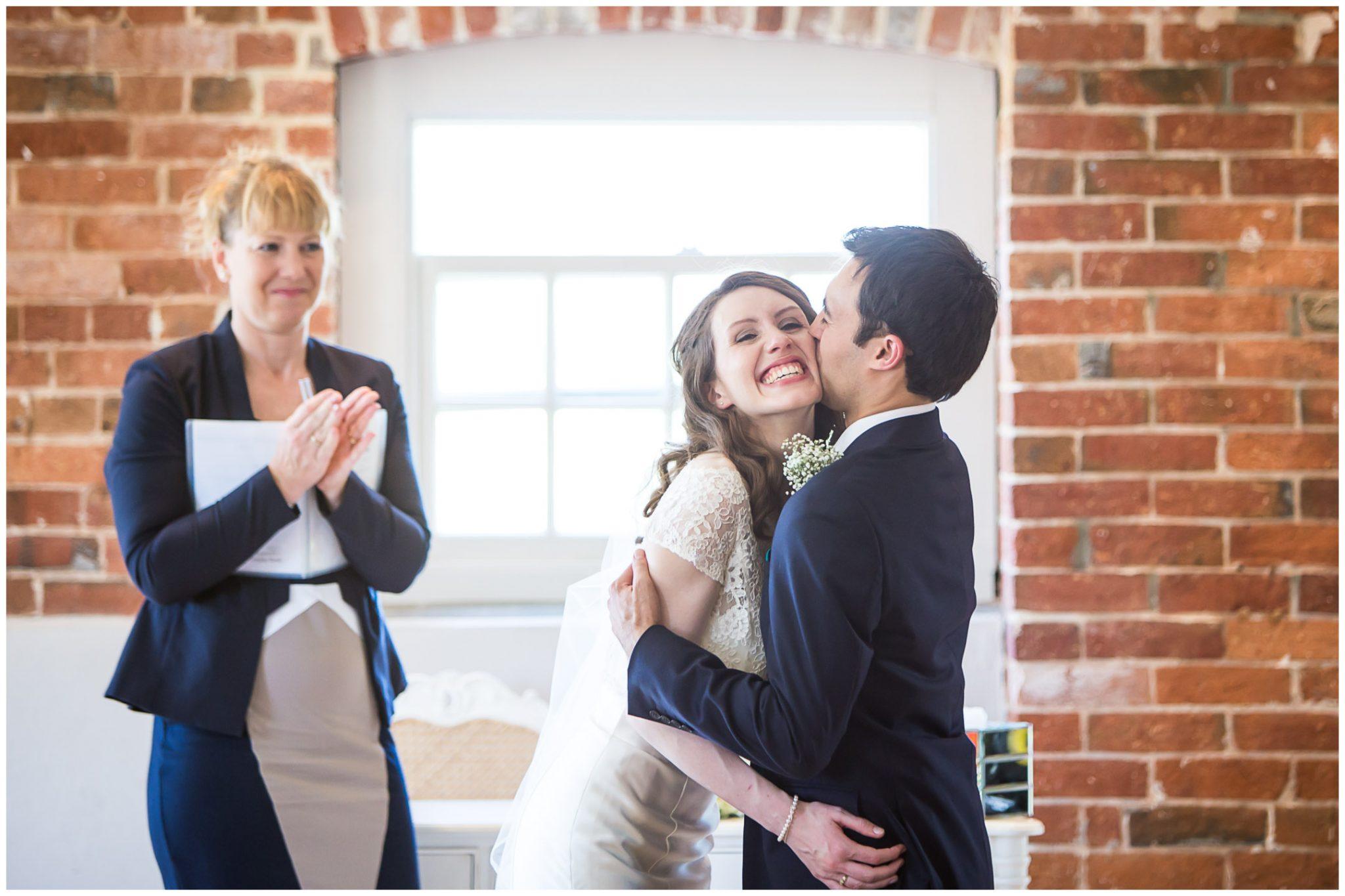 Sopley Mill Summer wedding groom kisses bride