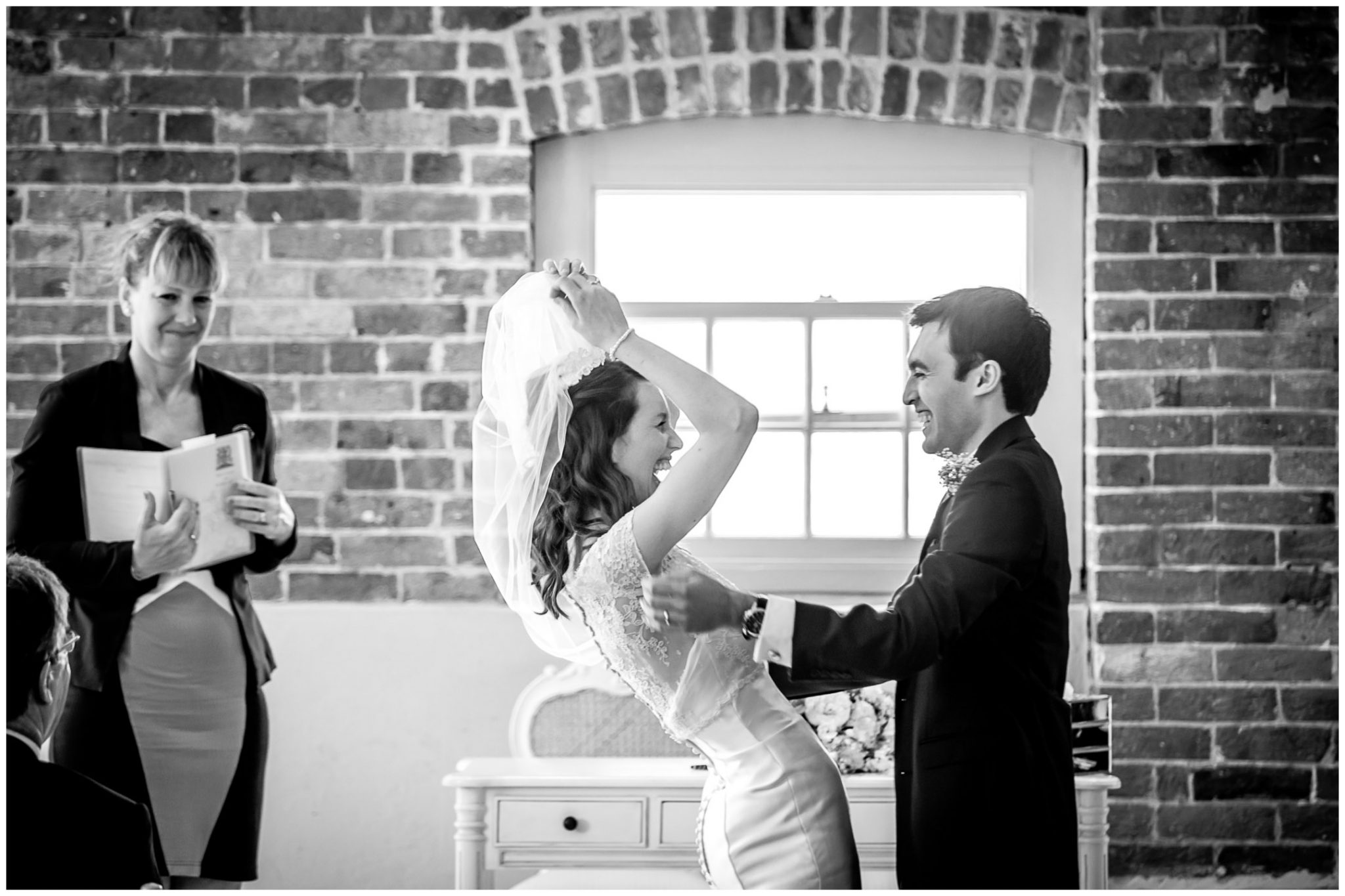 Sopley Mill Summer wedding newly married couple laughing as bride lifts veil