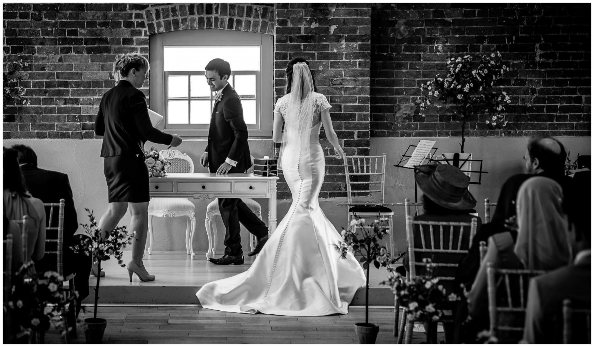 Sopley Mill Summer wedding black and white photo detailing bride in dress