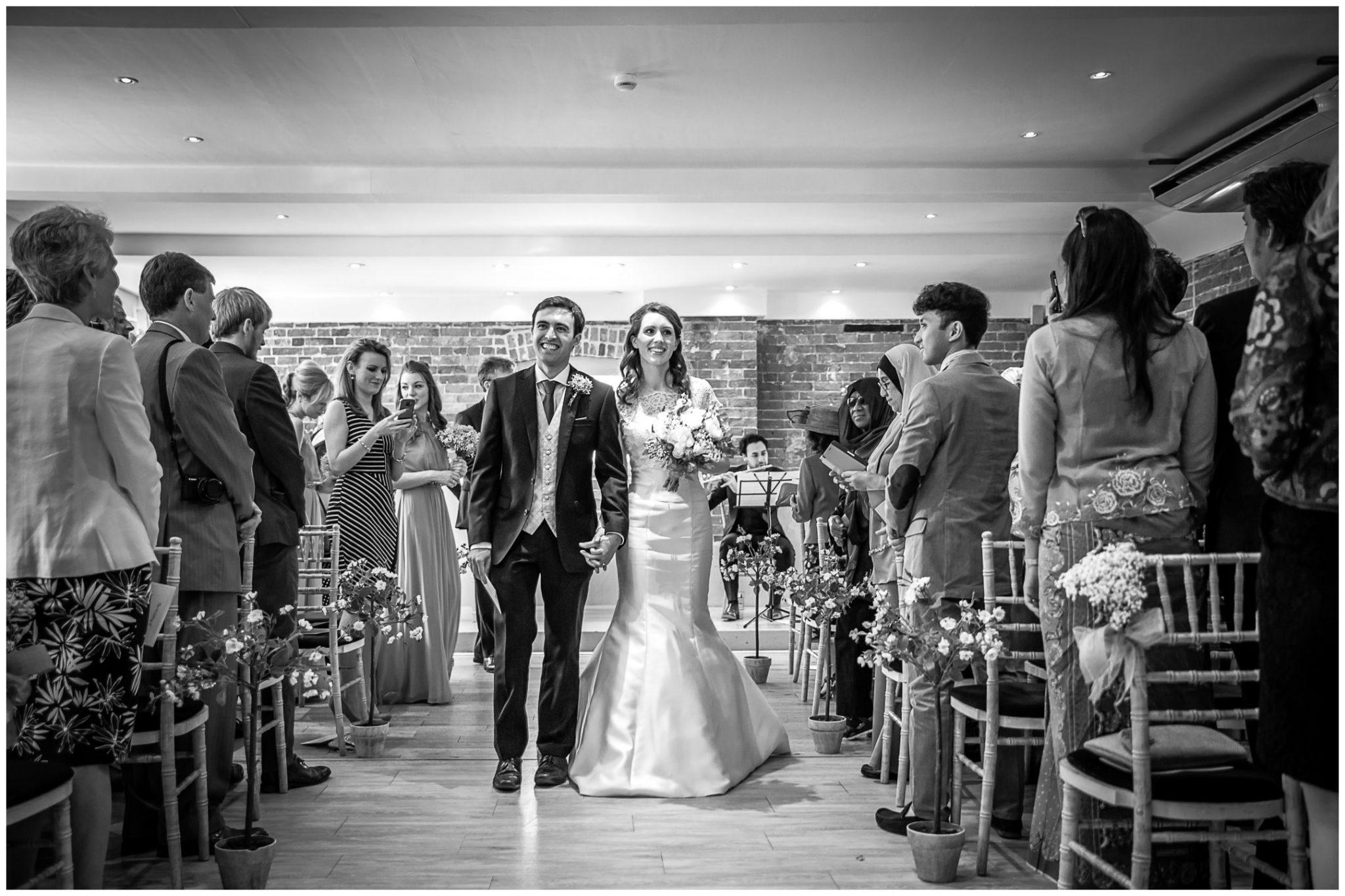 Sopley Mill Summer wedding bride and groom walk down the aisle