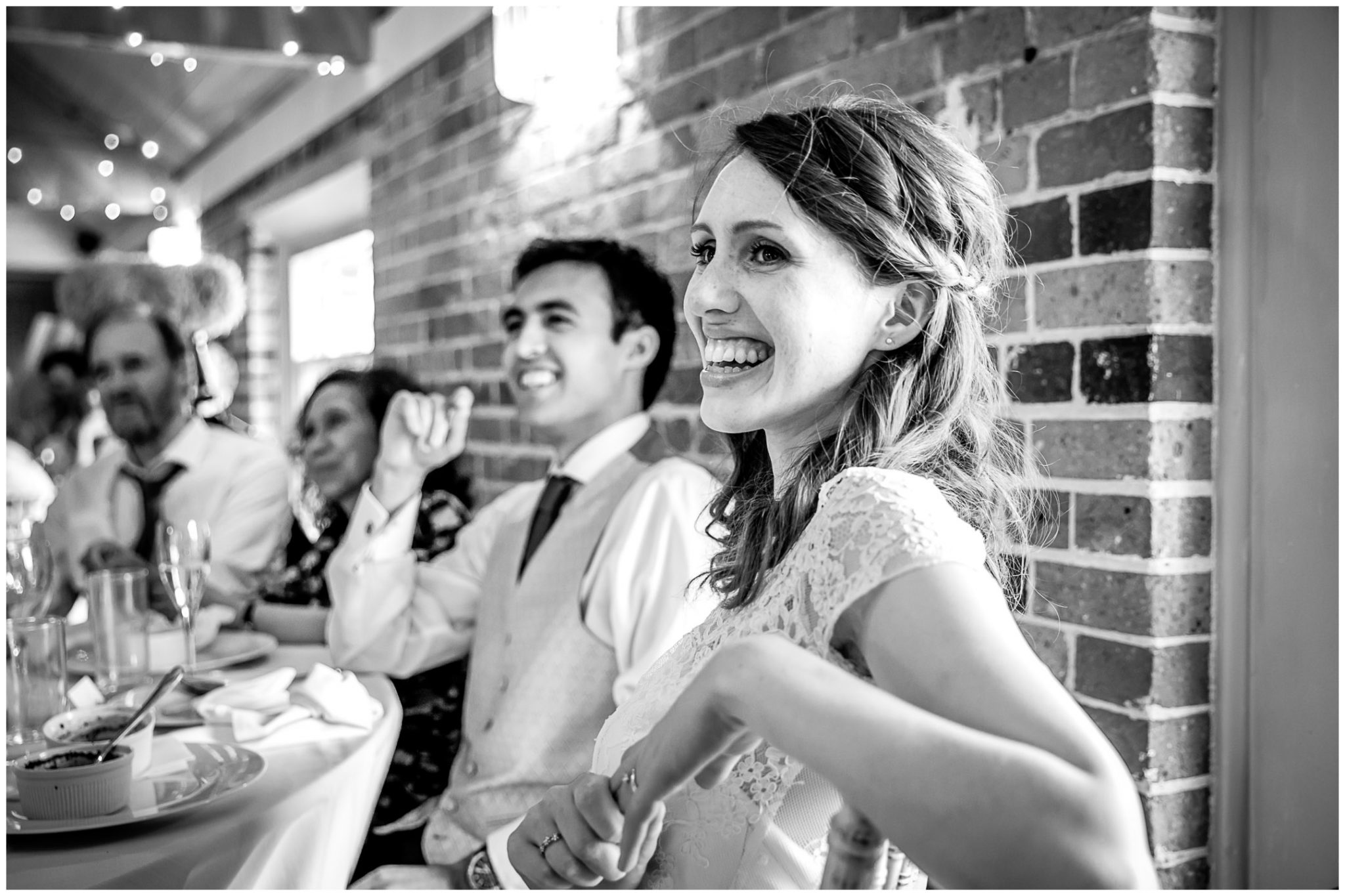 Sopley Mill Summer wedding bride laughs during speeches