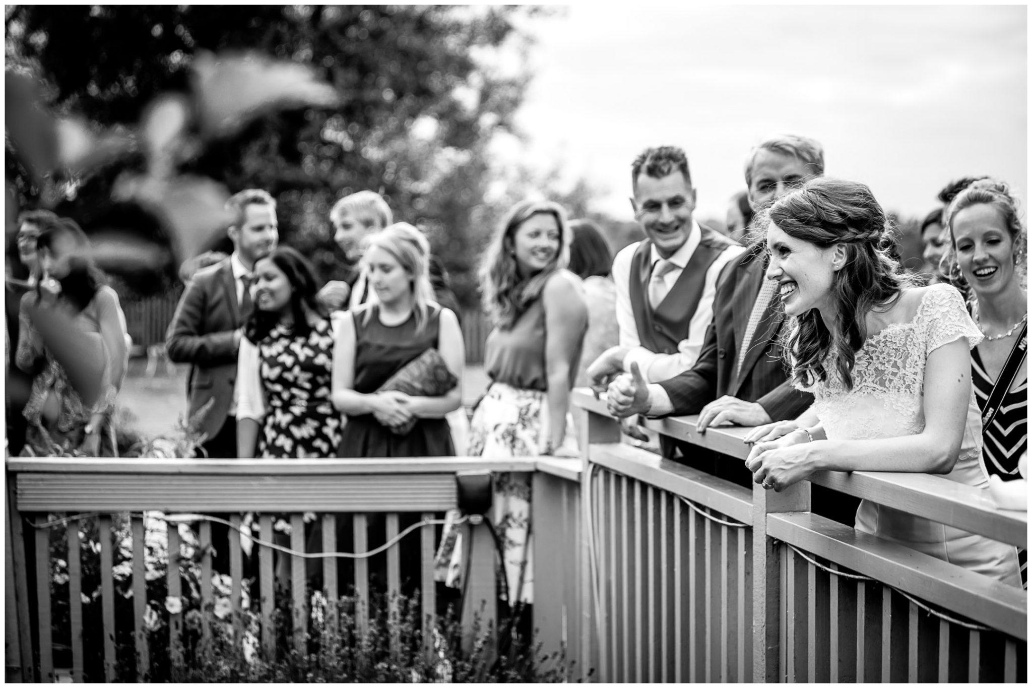 Sopley Mill Summer wedding bride watching the race