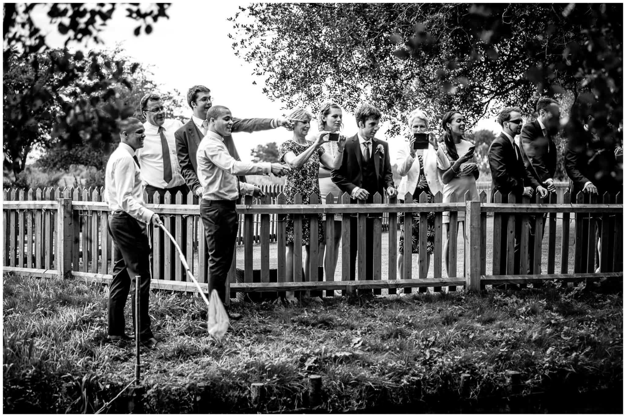 Sopley Mill Summer wedding guests watch duck race