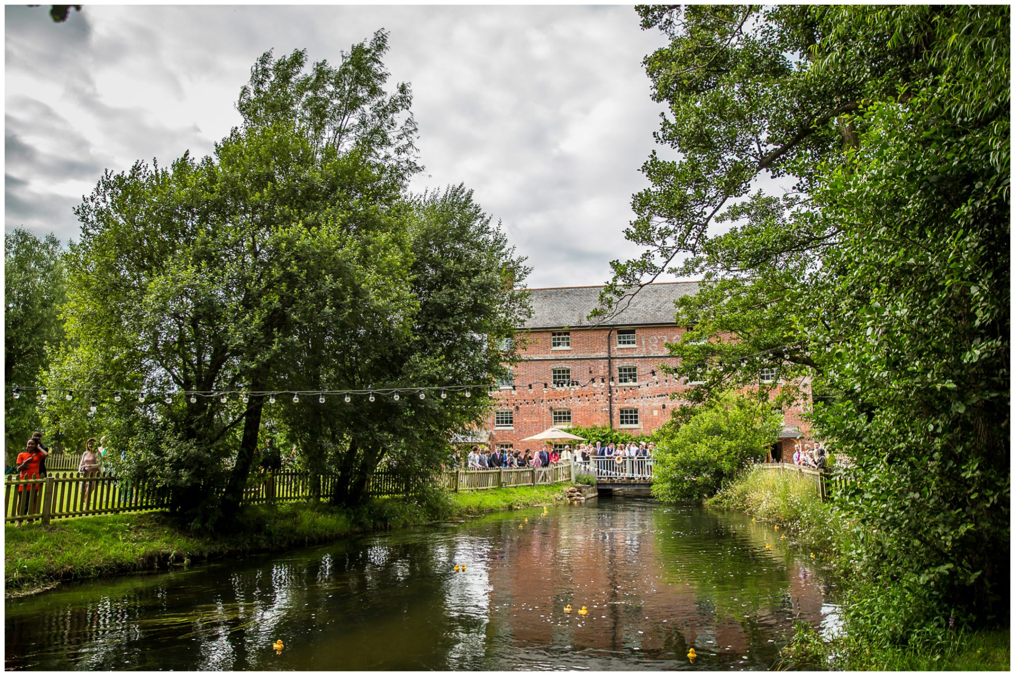 Sopley Mill Summer wedding view along the river to the mill