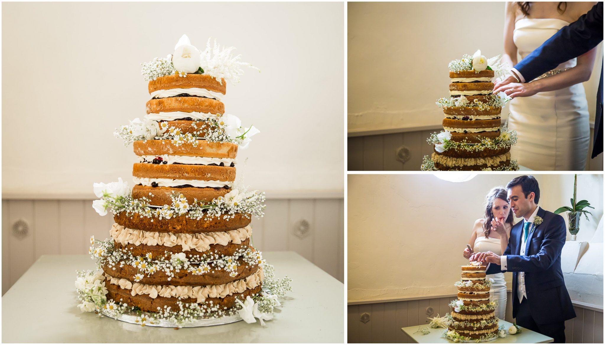 Sopley Mill Summer wedding cutting the cake