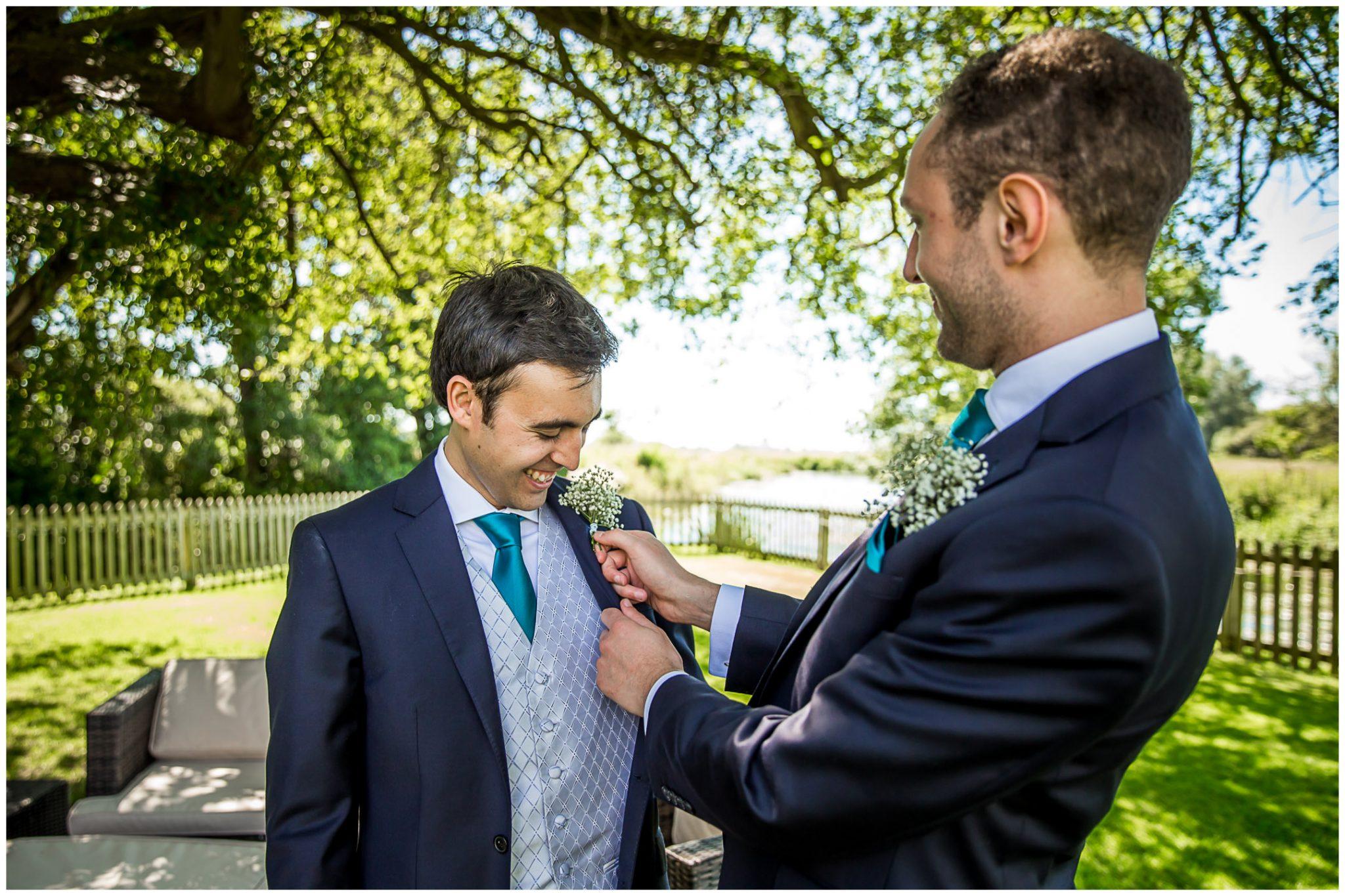 Sopley Mill Summer wedding groom with best man in gardens