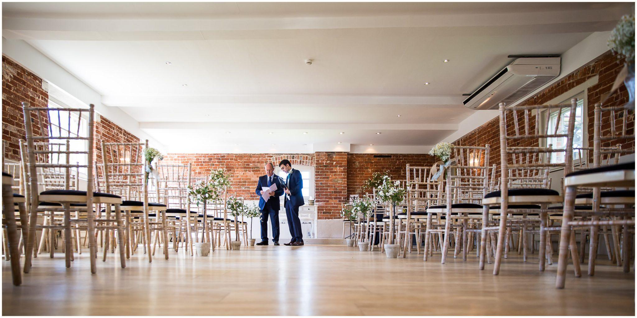 Sopley Mill Summer wedding groom with registrar before ceremony