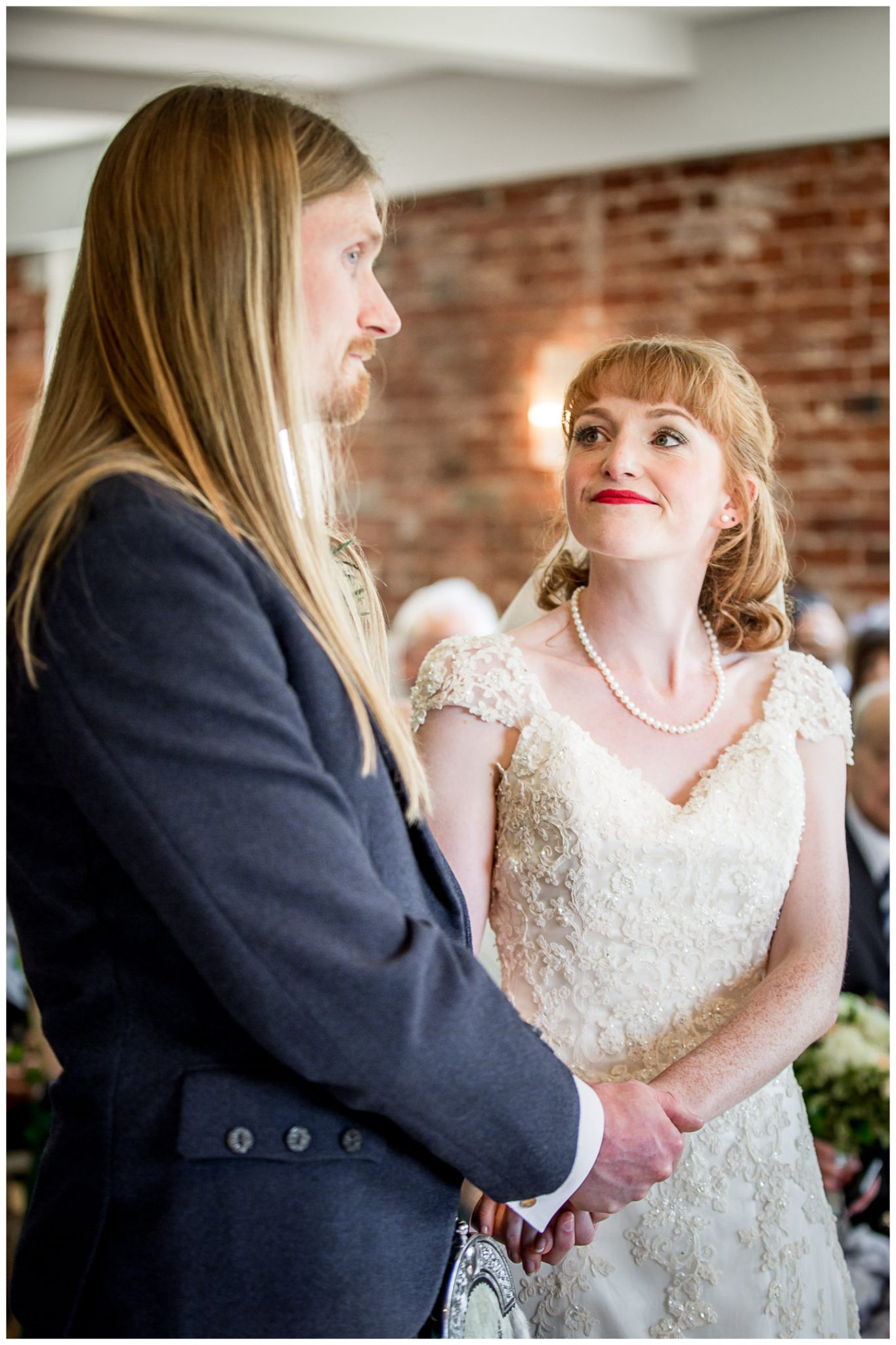 Bride looks at groom at start of marriage service
