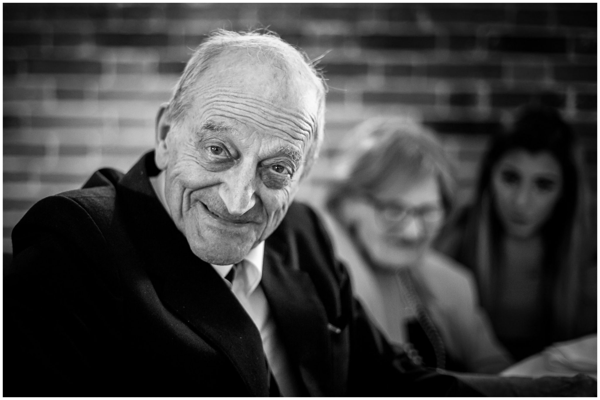 Grandfather black and whote portrait during wedding breakfast natural light