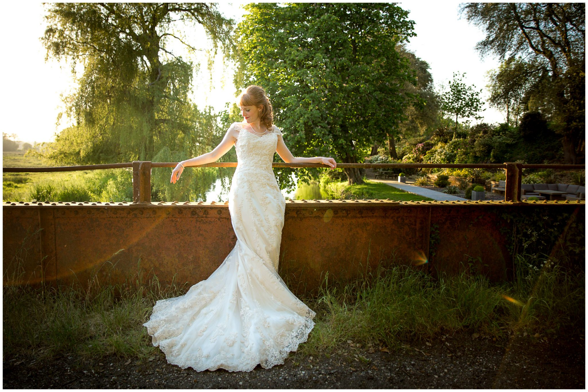 Bride portrait on iron bridge behind Sopley Mill