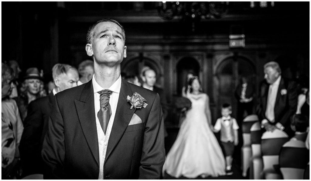 Groom reaction as bride walks down aisle