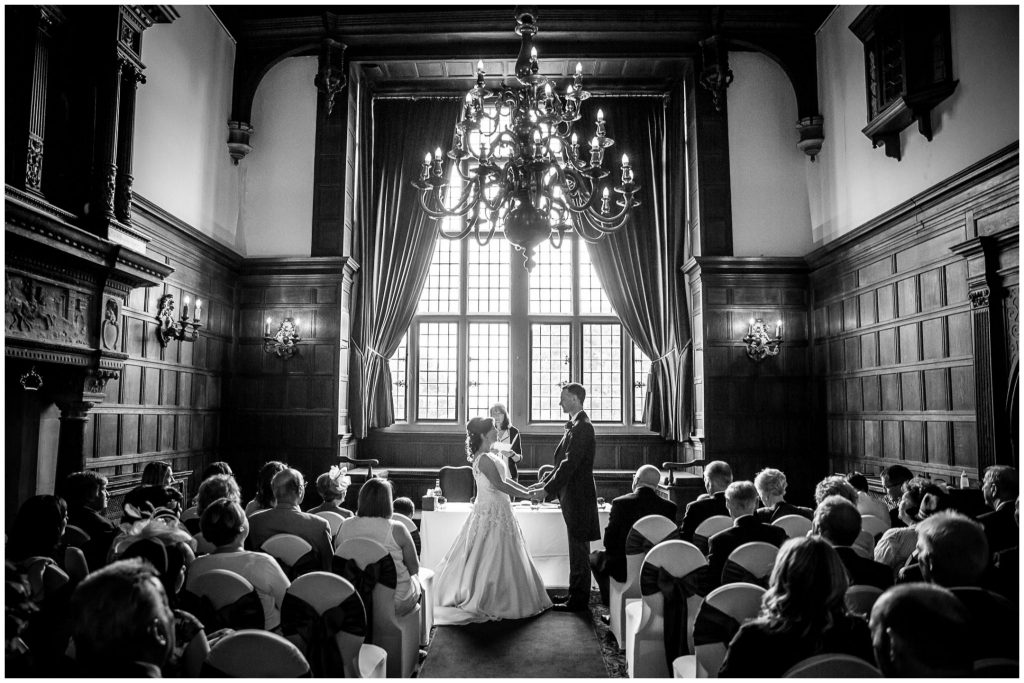 Black and white photo of ceremony room from the rear with large window
