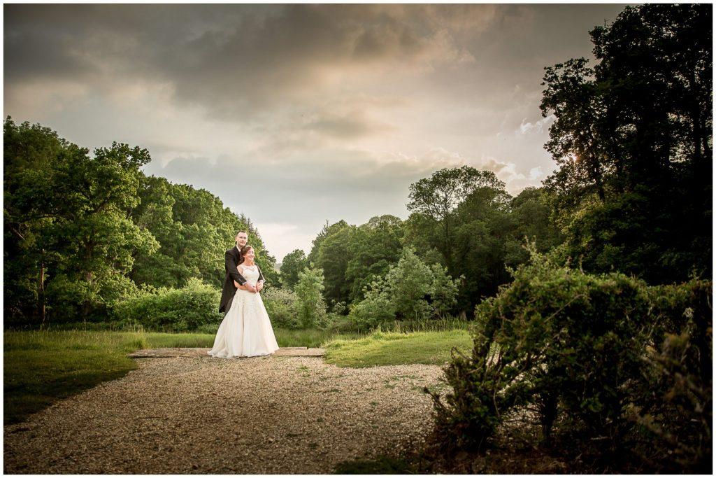 Bride and groom in gardens in evening light