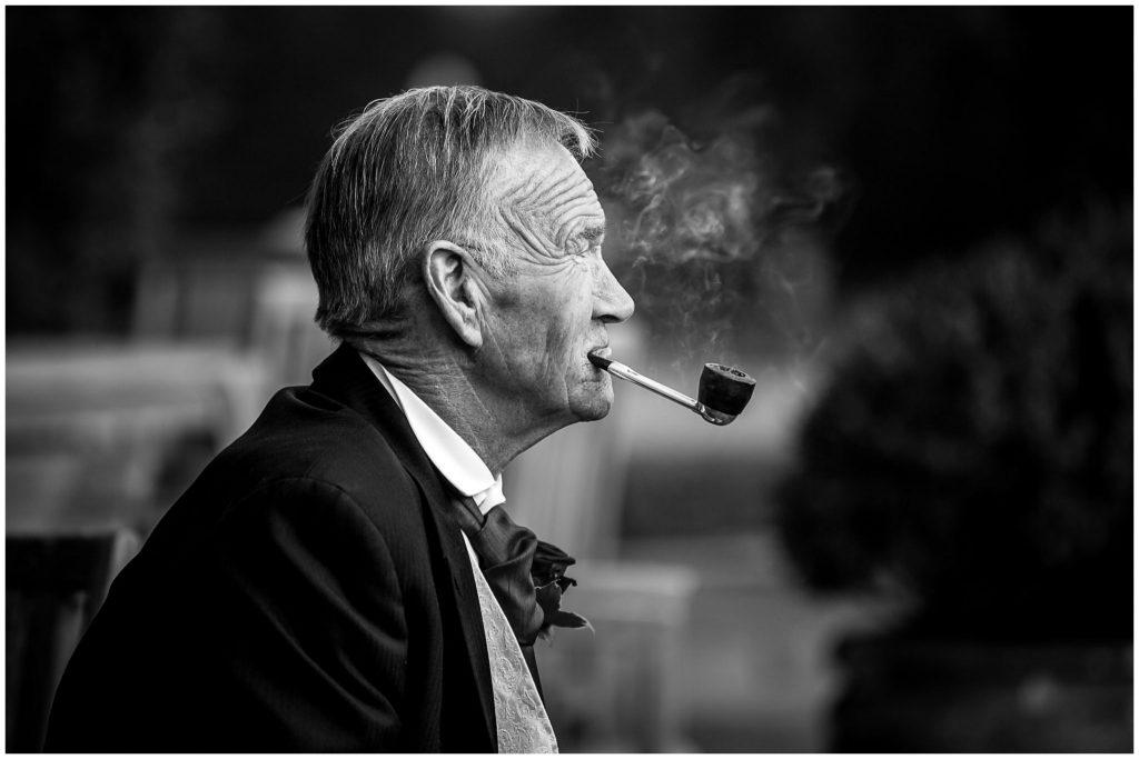 Man smoking pipe black and white