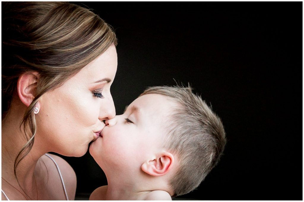 Bride and son kiss