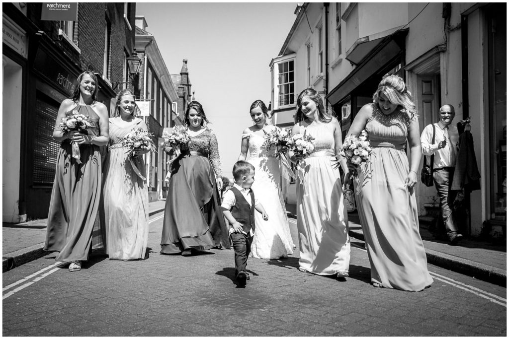 Bridal party walking along Parchment Street Winchester
