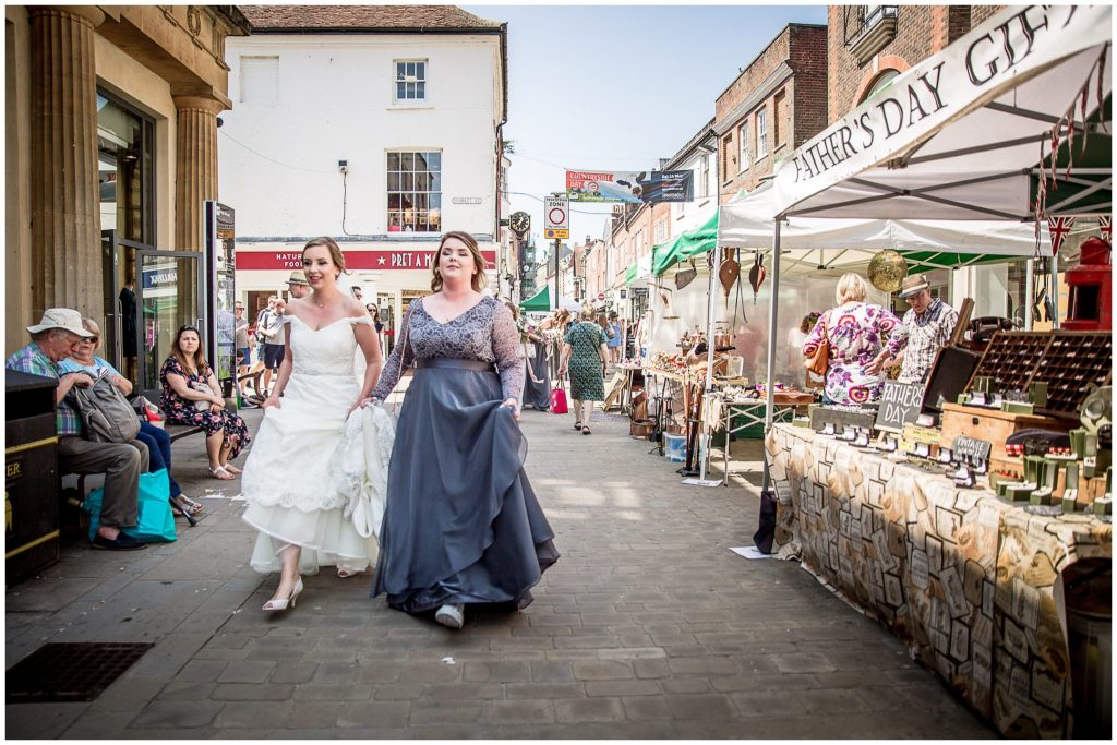 Bride and bridesmaid walk through Winchester centre