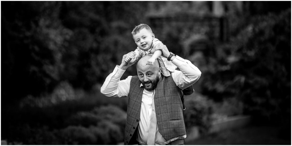 Groom with son in gardens