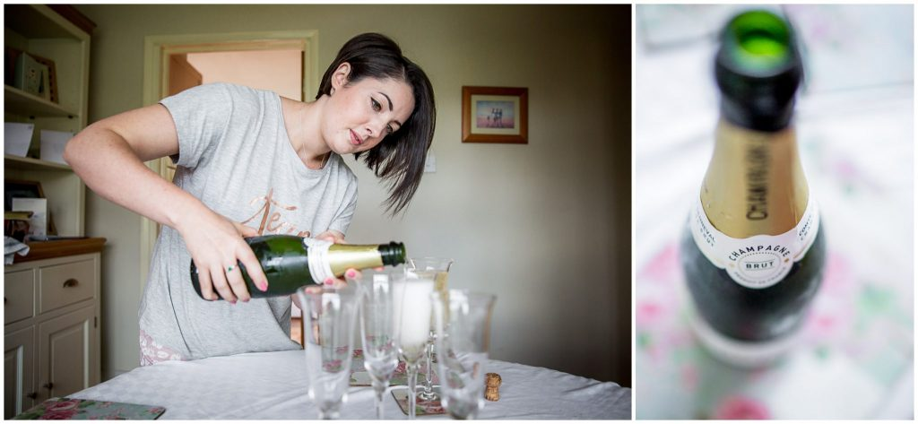 Bridesmaid pours champagne during wedding prep