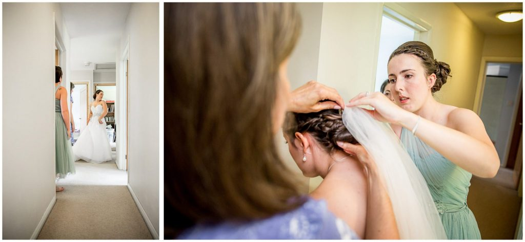 Bride looks in mirror and puts on veil