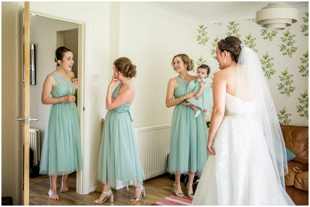 Bride and bridesmaids in dresses