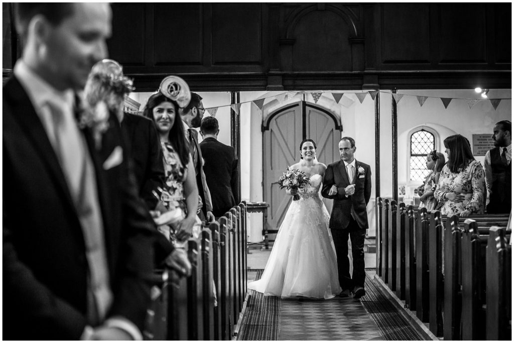 Bride walks down the aisle on her father's arm