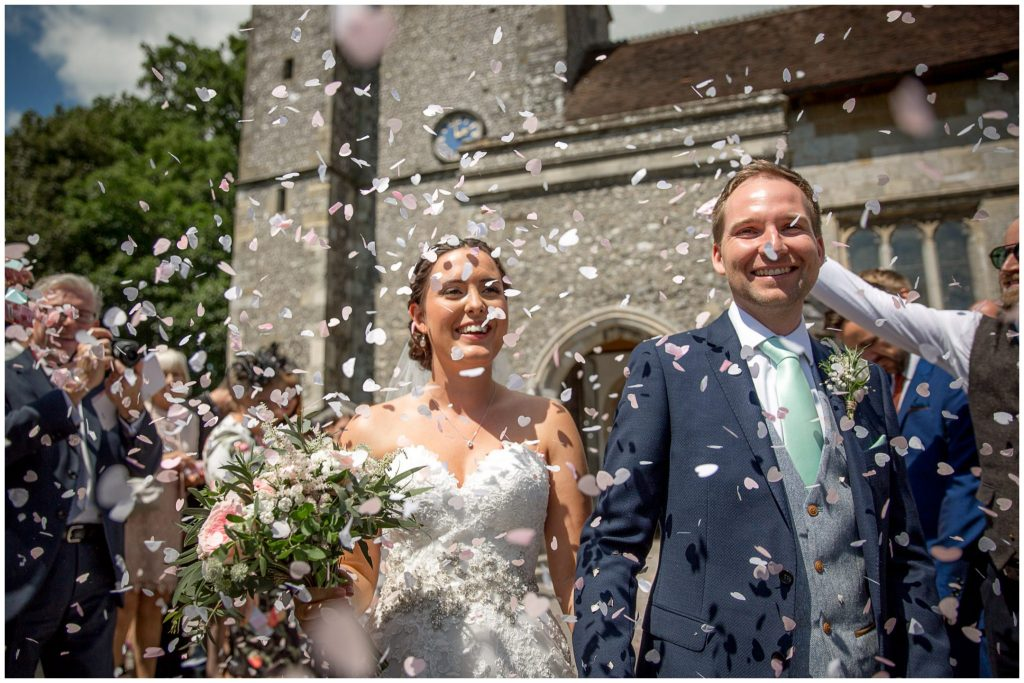 Couple exit to confetti shower