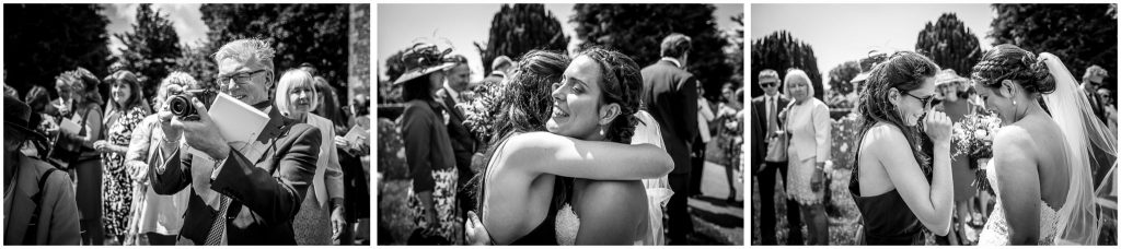 Hugs and kisses from wedding guests after ceremony