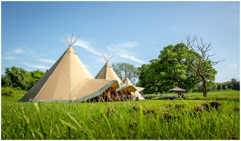 Tipi marquee exterior in summer sunshine