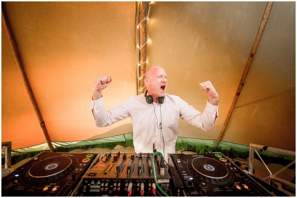 A wedding guests takes his turn to DJ