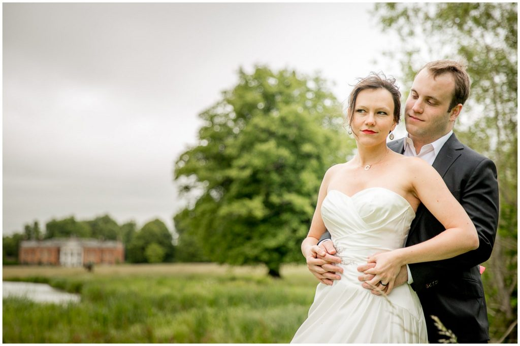 Bride and groom portrait on overcast day near Avington Park