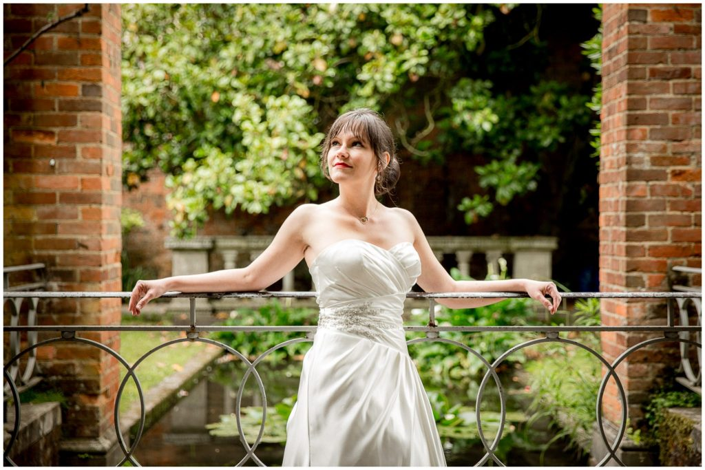 Bride portrait leaning on railings