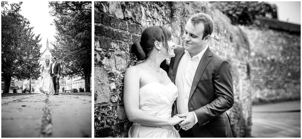 Black and white couple portraits in town centre with stone wall backdrop