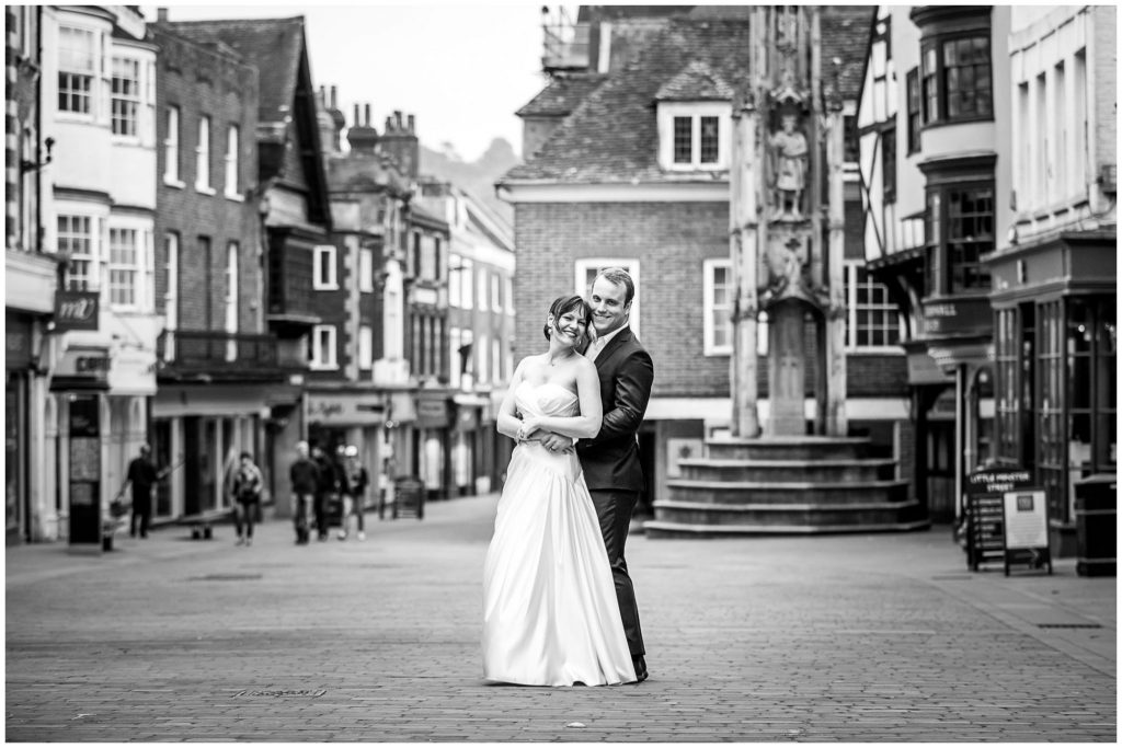 Bride and groom on Winchester High Street black and white
