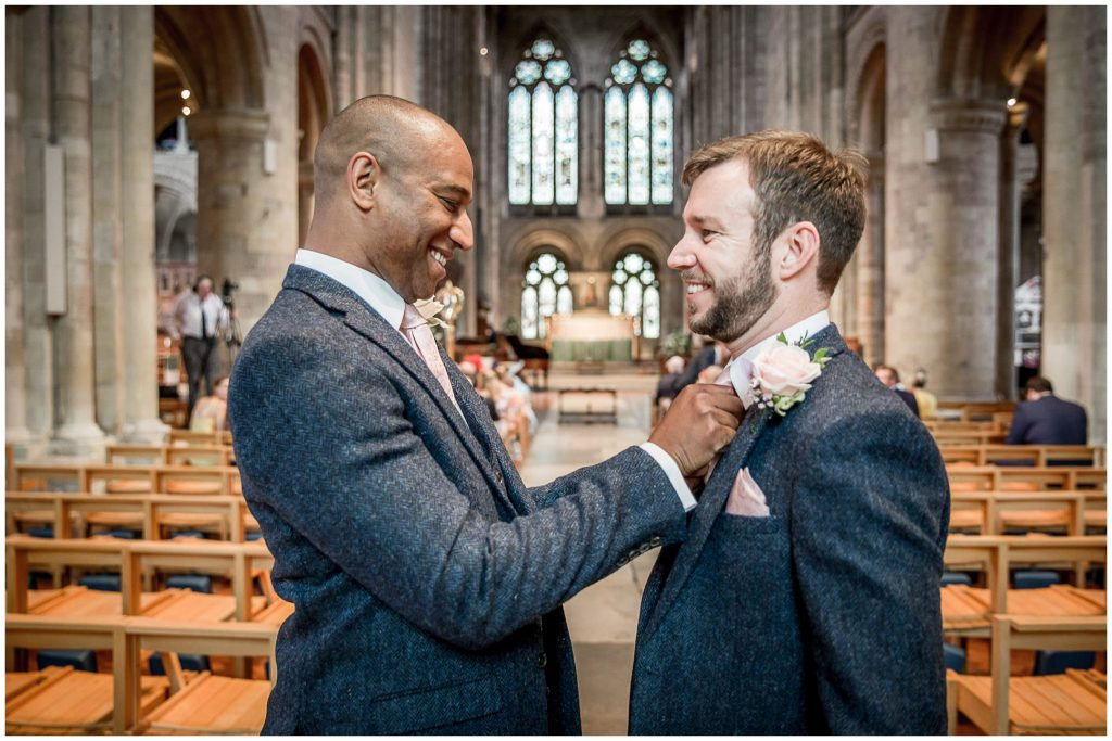 Groom with best man in Romsey Abbey