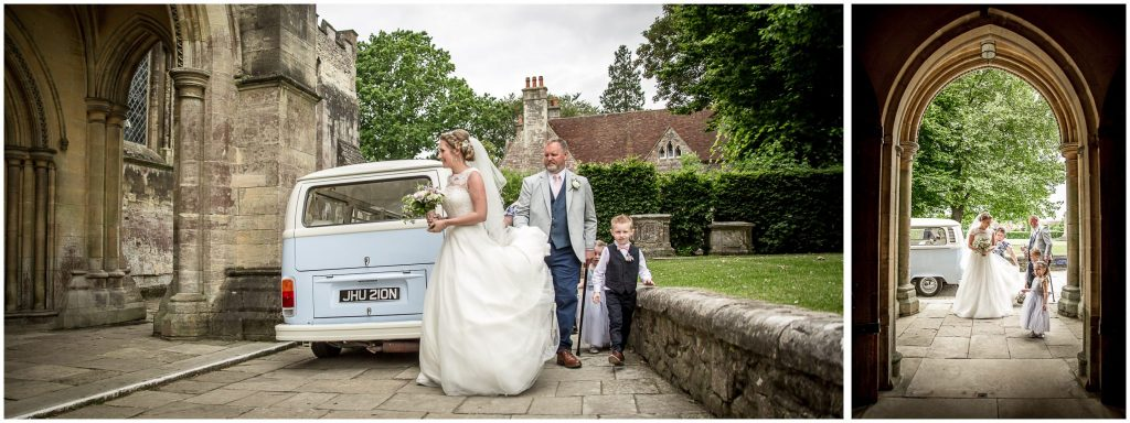 Bride arrives at Romsey Abbey and gets out of camper van