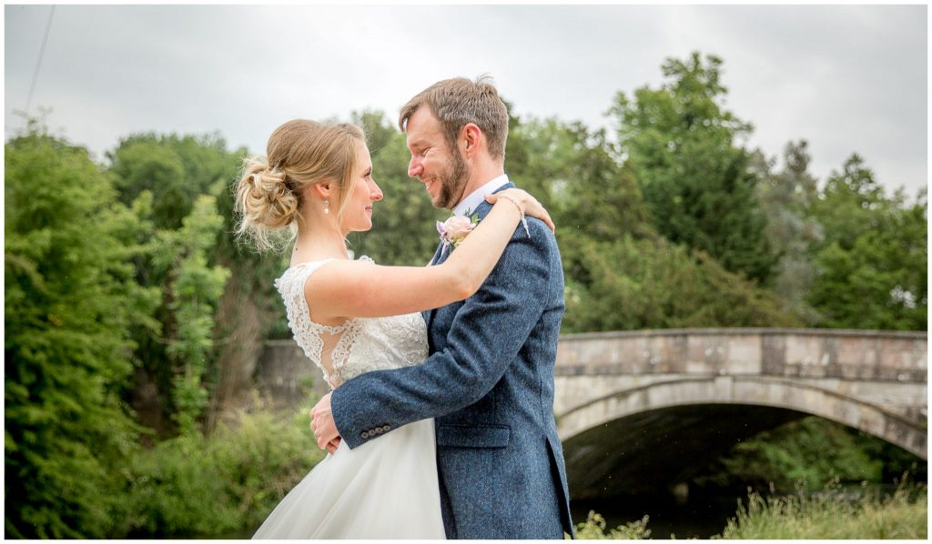 Riverside portrait bride and groom in Romsey after Abbey wedding
