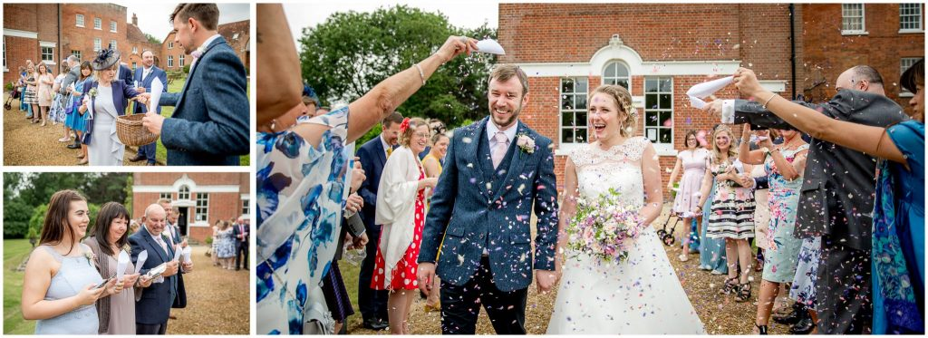 Guests greet bride and groom with confetti at reception venue