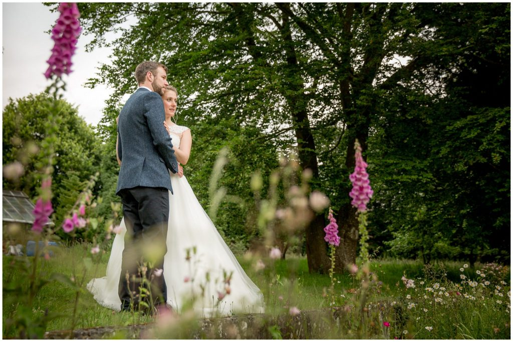 Couple portraits in gardens of reception venue