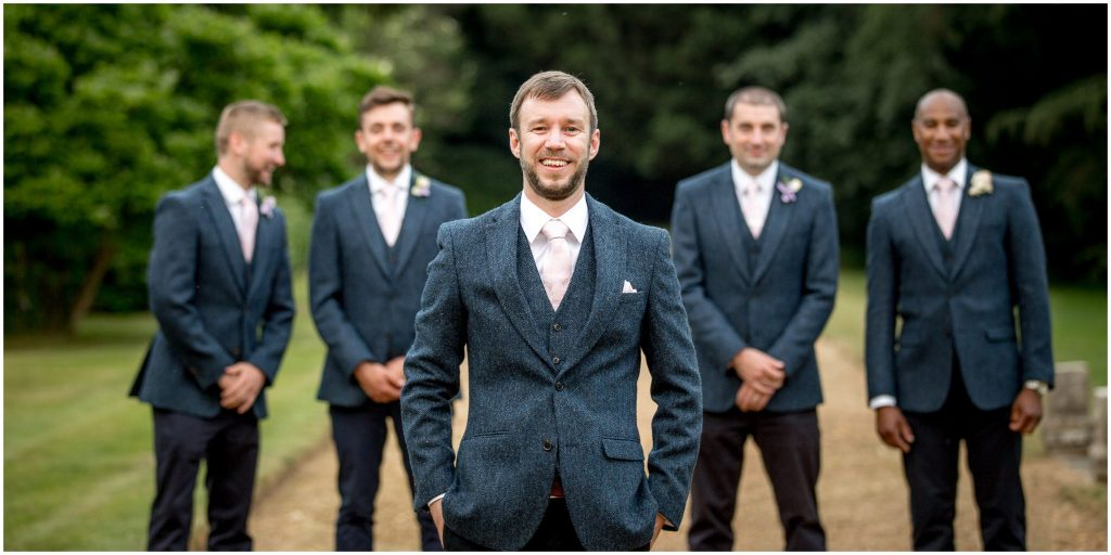 portrait of groom with groomsmen