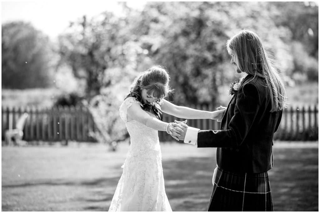 Bride and groom alone together black and white