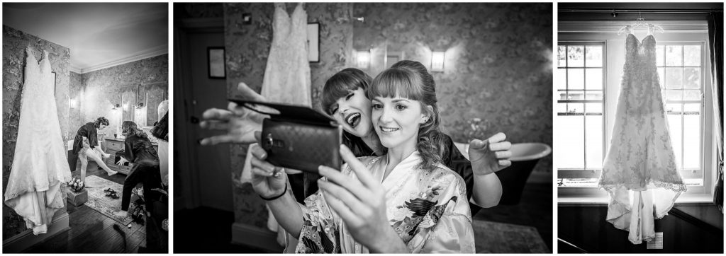 Bride selfie and dress hanging black and white