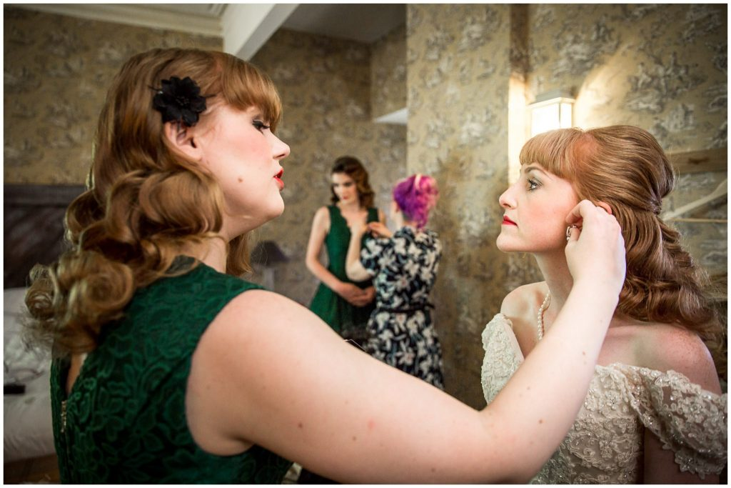 Bride puts on jewellery