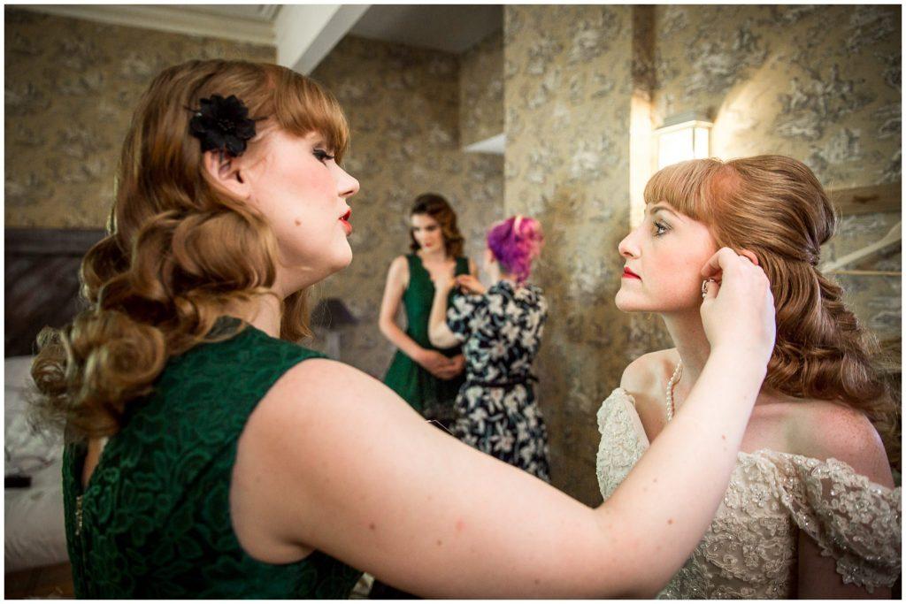 Bride puts on jewellery