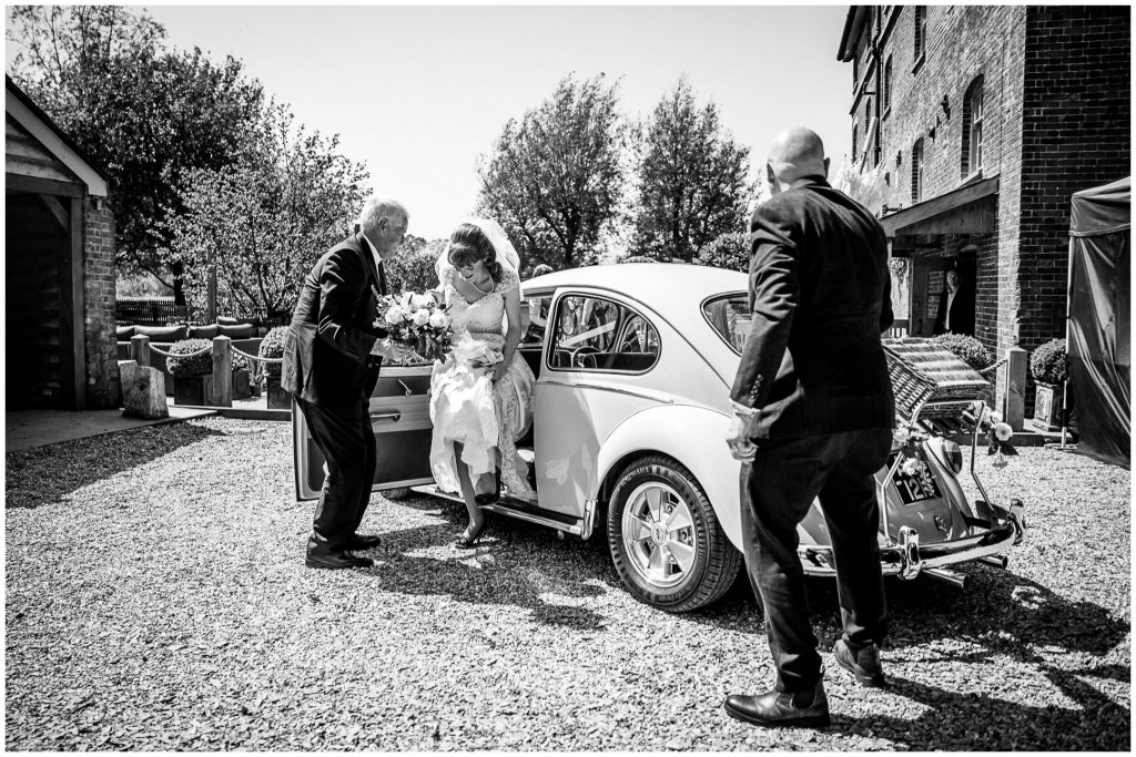 How to get out of a car in a wedding dress looking cool