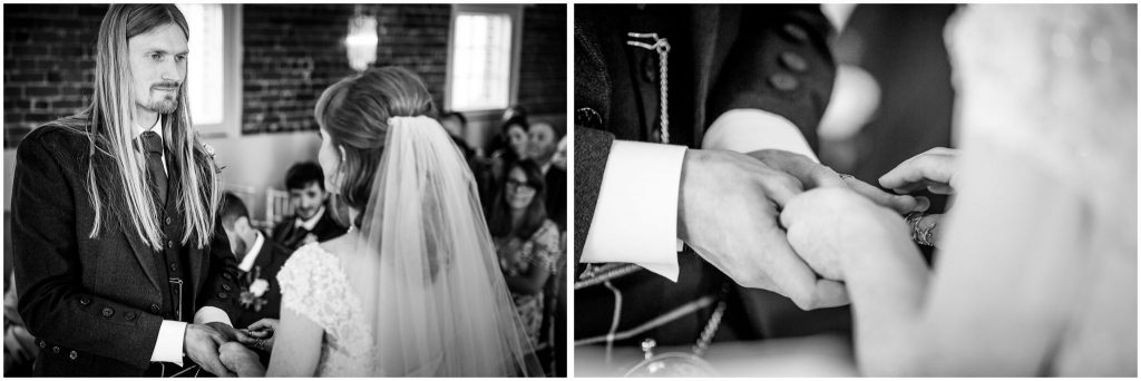 The bride places the wedding ring on the groom's hand, black and white photo