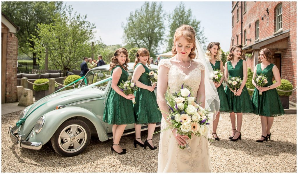 Colour photo green dresses bride with bridesmaids